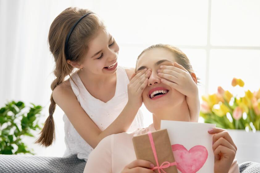girl surprising her mother